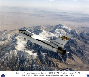 F-8 Digital Fly-by-Wire (DFBW) in flight over snow capped mountains