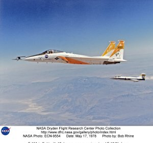 F-15A in flight with 10 degree cone experiment and F-104N chase