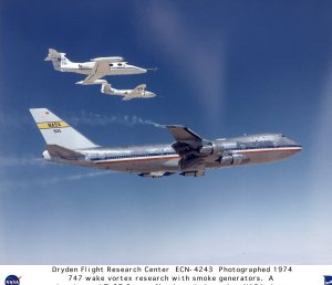 B-747 in Flight during Vortex Study with Learjet and T-37 Fly Through the Wake