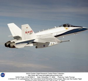 A NASA F/A-18, participating in the Automated Aerial Refueling (AAR) project, flies over the Dryden