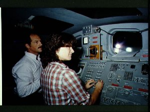 Two members of the STS-7 crew go over procedures in operating the RMS