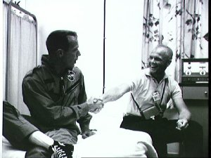 Astronaut Glenn congratulates Astronaut Carpenter on mission