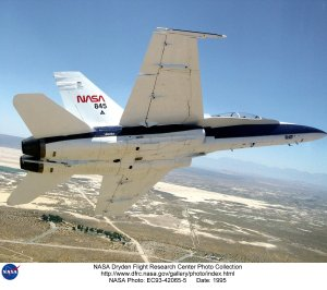 F-18 SRA in banked flight over lakebed
