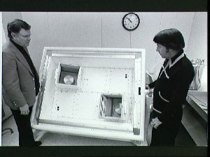 Astronauts Don Lind and Ernie Weeks with the Interstellar Gas Experiment