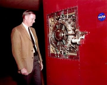 NEIL ARMSTRONG LOOKING OVER VSTOL VERTICAL SHORT TAKE OFF LANDING PROJECT