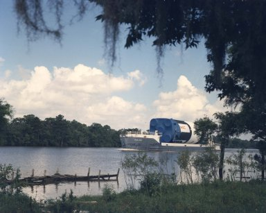 Saturn V First Stage Transferred by Barge