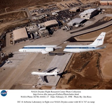 DC-8 Airborne Laboratory in flight over NASA Dryden center with SCA 747 on ramp