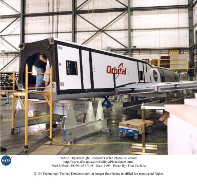 X-34 Technology Testbed Demonstrator on hangar floor being modified for unpowered flights