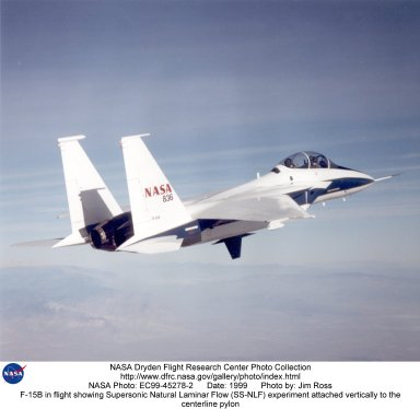 F-15B in flight showing Supersonic Natural Laminar Flow (SS-NLF) experiment attached vertically to t