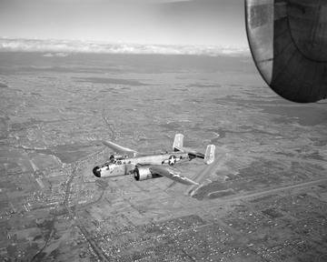B-25 AIRPLANE FLIGHT TEST SHOWING DE-ICING EQUIPMENT AND RESEARCH INSTALLATIONS