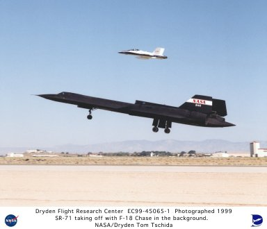 SR-71A Taking Off with Test Fixture Mounted Atop the Aft Section of the Aircraft and F-18 Chase Airc