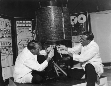 Engineers checkout Early Bird-Communication Satellite
