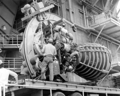 Space Shuttle Main Engine Hoisted into Test Stand
