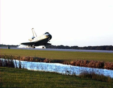 With Commander Kevin Kregel and Pilot Steven Lindsey at the controls, the orbiter Columbia touches its main gear down on Runway 33 at KSC?s Shuttle Landing Facility at 7:20:04 a.m. EST Dec. 5 to complete the 15-day, 16-hour and 34-minute-long STS-87 mission of 6.5 million miles. Also onboard the orbiter are Mission Specialists Winston Scott; Kalpana Chawla, Ph.D.; and Takao Doi, Ph.D., of the National Space Development Agency of Japan; along with Payload Specialist Leonid Kadenyuk of the National Space Agency of Ukraine. During the 88th Space Shuttle mission, the crew performed experiments on the United States Microgravity Payload-4 and pollinated plants as part of the Collaborative Ukrainian Experiment. This was the 12th landing for Columbia at KSC and the 41st KSC landing in the history of the Space Shuttle program
