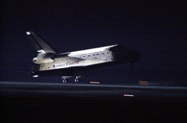 KENNEDY SPACE CENTER, Fla. -- Landing lights spotlight Space Shuttle Atlantis as it nears touchdown on Runway 15 at KSC?s Shuttle Landing Facility after completing the 9-day, 20-hour, 9-minute-long STS-101 mission. At the controls are Commander James D. Halsell Jr. and Pilot Scott ?Doc? Horowitz. Also onboard the orbiter are Mission Specialists Mary Ellen Weber, James S. Voss, Jeffrey N. Williams, Susan J. Helms and Yury Usachev of Russia. The crew is returning from the third flight to the International Space Station. This was the 98th flight in the Space Shuttle program and the 21st for Atlantis, also marking the 51st landing at KSC, the 22nd consecutive landing at KSC, and the 29th in the last 30 Shuttle flights. Main gear touchdown was at 2:20:17 a.m. EDT, landing on orbit 155 of the mission. Nose gear touchdown was at 2:20:30 a.m. EDT, and wheel stop at 2:21:19 a.m. EDT
