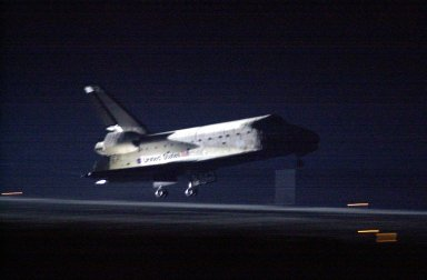 KENNEDY SPACE CENTER, Fla. -- Glowing in the lights from Runway 15, Space Shuttle Atlantis nears touchdown at KSC?s Shuttle Landing Facility after completing the 9-day, 20-hour, 9-minute-long STS-101 mission. At the controls are Commander James D. Halsell Jr. and Pilot Scott ?Doc? Horowitz. Also onboard the orbiter are Mission Specialists Mary Ellen Weber, James S. Voss, Jeffrey N. Williams, Susan J. Helms and Yury Usachev of Russia. The crew is returning from the third flight to the International Space Station. This was the 98th flight in the Space Shuttle program and the 21st for Atlantis, also marking the 51st landing at KSC, the 22nd consecutive landing at KSC, and the 29th in the last 30 Shuttle flights. Main gear touchdown was at 2:20:17 a.m. EDT, landing on orbit 155 of the mission. Nose gear touchdown was at 2:20:30 a.m. EDT, and wheel stop at 2:21:19 a.m. EDT