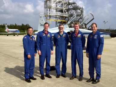 The STS-97 crew pose for a photo on the parking area of the Shuttle Landing Facility after their arrival in the T-38 jet aircraft behind them. From left, they are Mission Specialist Carlos Noriega, Joe Tanner and Marc Garneau (with the Canadian Space Agency); Commander Brent Jett; and Pilot Mike Bloomfield. The crew is at KSC to take part in Terminal Countdown Demonstration Test activities that include emergency egress training, familiarization with the payload, and a simulated launch countdown. Mission STS-97is the sixth construction flight to the International Space Station. Its payload includes the P6 Integrated Truss Structure and a photovoltaic (PV) module, with giant solar arrays that will provide power to the Station. The mission includes two spacewalks to complete the solar array connections. STS-97 is scheduled to launch Nov. 30 at about 10:05 p.m. EST