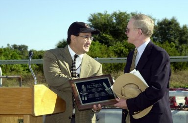 At the commissioning of a new high-pressure helium pipeline at Kennedy Space Center, Ramon Lugo, acting executive director, JPMO , presents a plaque to Center Director Roy Bridges. The pipeline will service launch needs at the new Delta IV Complex 37 at Cape Canaveral Air Force Station. Others at the ceremony were Jerry Jorgensen, pipeline project manager, Space Gateway Support (SGS); Col. Samuel Dick, representative of the 45th Space Wing; David Herst, director, Delta IV Launch Sites; Pierre Dufour, president and CEO, Air Liquide America Corporation; and Michael Butchko, president, SGS. The nine-mile-long buried pipeline will also serve as a backup helium resource for Shuttle launches. Nearly one launch?s worth of helium will be available in the pipeline to support a Shuttle pad in an emergency. The line originates at the Helium Facility on KSC and terminates in a meter station at the perimeter of the Delta IV launch pad