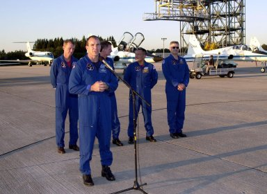 After their arrival at the Shuttle Landing Facility, the STS-97 crew gather to address the media. At the microphone is Pilot Michael Bloomfield. Behind him stand Commander Brent Jett and Mission Specialists Joseph Tanner, Carolos Noriega and Marc Garneau, who is with the Canadian Space Agency. Mission STS-97is the sixth construction flight to the International Space Station. Its payload includes the P6 Integrated Truss Structure and a photovoltaic (PV) module, with giant solar arrays that will provide power to the Station. The mission includes two spacewalks to complete the solar array connections. STS-97 is scheduled to launch Nov. 30 at about 10:06 p.m. EST