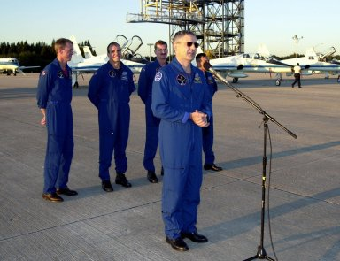 After their arrival at the Shuttle Landing Facility, the STS-97 crew gather to address the media. At the microphone is Mission Specialist Marc Garneau, who is with the Canadian Space Agency. Behind him stand Commander Brent Jett, Pilot Michael Bloomfield and Mission Specialists Joseph Tanner and Carlos Noriega. Mission STS-97is the sixth construction flight to the International Space Station. Its payload includes the P6 Integrated Truss Structure and a photovoltaic (PV) module, with giant solar arrays that will provide power to the Station. The mission includes two spacewalks to complete the solar array connections. STS-97 is scheduled to launch Nov. 30 at about 10:06 p.m. EST