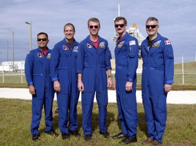 Gathered at Launch Pad 39B, the STS-97 crew pause for a photo. Standing left to right are Mission Specialist Carlos Noriega, Pilot Michael Bloomfield, Commander Brent Jett and Mission Specialists Joseph Tanner and Marc Garneau, who is with the Canadian Space Agency. The mission to the International Space Station carries the P6 Integrated Truss Segment containing solar arrays and batteries that will be temporarily installed to the Unity connecting module by the Z1 truss, recently delivered to and installed on the Station on mission STS-92. The two solar arrays are each more than 100 feet long. They will capture energy from the sun and convert it to power for the Station. Two spacewalks will be required to install the solar array connections. STS-97 is scheduled to launch Nov. 30 at about 10:06 p.m. EST