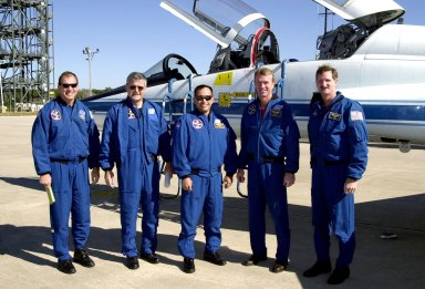 The STS-97 crew poses for a photo after landing at KSC?s Shuttle Landing Facility. Standing, left to right, are Pilot Mike Bloomfield, Mission Specialists Marc Garneau and Carlos Noriega, Commander Brent Jett and Mission Specialist Joe Tanner. They are at KSC for a mini-CEIT (Crew Equipment Interface Test). STS-97 is scheduled to launch Nov. 30 at 10:06 p.m. EST from Launch Pad 39B. The sixth flight to the International Space Station, the mission is expected to last 11 days, with a planned KSC landing at about 5:58 p.m. Dec. 11