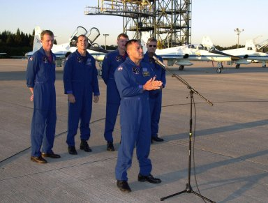 After their arrival at the Shuttle Landing Facility, the STS-97 crew gather to address the media. At the microphone is Mission Specialist Carlos Noriega. Behind him stand Commander Brent Jett, Pilot Michael Bloomfield and Mission Specialists Joseph Tanner and Marc Garneau, who is with the Canadian Space Agency. Mission STS-97is the sixth construction flight to the International Space Station. Its payload includes the P6 Integrated Truss Structure and a photovoltaic (PV) module, with giant solar arrays that will provide power to the Station. The mission includes two spacewalks to complete the solar array connections. STS-97 is scheduled to launch Nov. 30 at about 10:06 p.m. EST