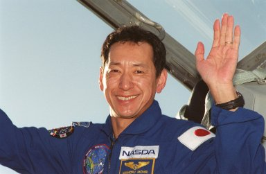 STS-99 Mission Specialist Mamoru Mohri, who is with the National Space Development Agency (NASDA) of Japan, waves after his arrival at KSC aboard a T-38 training jet aircraft to take part in a Terminal Countdown Demonstration Test (TCDT). The TCDT provides the crew with simulated countdown exercises, emergency egress training, and opportunities to inspect the mission payloads in the orbiter's payload bay. Other crew members taking part are Commander Kevin Kregel, Pilot Dominic L. Pudwill Gorie, and Mission Specialists Janet Lynn Kavandi (Ph.D.), Janice Voss (Ph.D.), and Gerhard P.J. Thiele, with the European Space Agency. STS-99 is the Shuttle Radar Topography Mission, which will chart a new course, using two antennae and a 200-foot-long section of space station-derived mast protruding from the payload bay to produce unrivaled 3-D images of the Earth's surface. The result of the Shuttle Radar Topography Mission could be close to 1 trillion measurements of the Earth's topography. Besides contributing to the production of better maps, these measurements could lead to improved water drainage modeling, more realistic flight simulators, better locations for cell phone towers, and enhanced navigation safety. Launch of Endeavour on the 11-day mission is scheduled for Jan. 31 at 12:47 p.m. EST