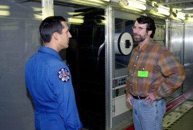 """KENNEDY SPACE CENTER, FLA. -- Astronaut John Herrington (left) and Norm Abram, master carpenter of television?s """"This Old House"""" and """"The New Yankee Workshop,"""" talk in front of a mockup of the U.S. Lab. Abram is at KSC to film an episode of """"This Old House."""" The mockup lab is in the International Space Station Center, a tour facility"""