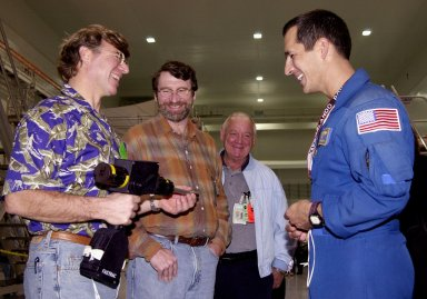 """Astronaut John Herrington (right) shares a humorous moment with Steve Thomas (left) and Norm Abram (second from left), who are seen in the television series """" This Old House."""" In the background is Johnny Johnson, media escort. Abram is at KSC to film an episode of """"This Old House."""