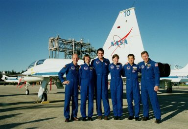 The STS-99 crew pose for a photo after their arrival at KSC's Shuttle Landing Facility. From left are Mission Specialists Gerhard Thiele, and Janice Voss (Ph.D.), Commander Kevin Kregel, Mission Specialists Janet Lynn Kavandi (Ph.D.) and Mamoru Mohri, and Pilot Dominic Gorie. Thiele is with the European Space Agency and Mohri is with the National Space Development Agency (NASDA) of Japan. The crew are here to take part in a Terminal Countdown Demonstration Test (TCDT), which provides simulated countdown exercises, emergency egress training, and opportunities to inspect the mission payloads in the orbiter's payload bay. STS-99 is the Shuttle Radar Topography Mission, which will chart a new course, using two antennae and a 200-foot-long section of space station-derived mast protruding from the payload bay to produce unrivaled 3-D images of the Earth's surface. The result of the Shuttle Radar Topography Mission could be close to 1 trillion measurements of the Earth's topography. Besides contributing to the production of better maps, these measurements could lead to improved water drainage modeling, more realistic flight simulators, better locations for cell phone towers, and enhanced navigation safety. Launch of Endeavour on the 11-day mission is scheduled for Jan. 31 at 12:47 p.m. EST