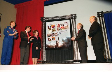 """A new series of U.S. Postage stamps, The 1980s, is unveiled at the KSC Visitors Complex. Shown taking part in the """"First Day of Issue Ceremony"""" are (left to right) astronaut Richard Linnehan, U.S. Representative, 15th Congressional District, Dave Weldon, U.S. Postal Service District Manager Viki Brennan, Center Director Roy Bridges and President of the Visitor Complex Rick Abramson. Among the stamps issued is one of Space Shuttle Columbia, first launched in April 1981. This collection of stamps is the ninth in the Post Office's """"Celebrate the Century"""" commemorative series honoring the last 100 years of American history"""