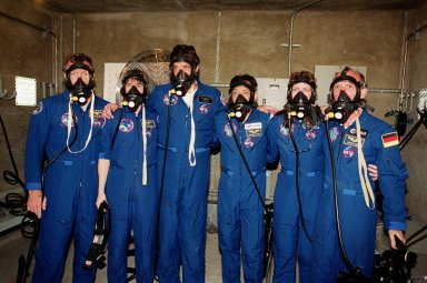 KENNEDY SPACE CENTER, Fla. -- In the bunker at Launch Pad 39A, the STS-99 crew try on oxygen masks. From left are Pilot Dominic Gorie, Mission Specialist Janice Voss (Ph.D.), Commander Kevin Kregel, and Mission Specialists Mamoru Mohri, Janet Lynn Kavandi (Ph.D.) and Gerhard Thiele. Mohri is with the National Space Development Agency (NASDA) of Japan and Thiele is with the European Space Agency. The crew are taking part in Terminal Countdown Demonstration Test activities, which provide them with simulated countdown exercises, emergency egress training, and opportunities to inspect the mission payloads in the orbiter's payload bay. STS-99 is the Shuttle Radar Topography Mission, which will chart a new course, using two antennae and a 200-foot-long section of space station-derived mast protruding from the payload bay to produce unrivaled 3-D images of the Earth's surface. The result of the Shuttle Radar Topography Mission could be close to 1 trillion measurements of the Earth's topography. Besides contributing to the production of better maps, these measurements could lead to improved water drainage modeling, more realistic flight simulators, better locations for cell phone towers, and enhanced navigation safety. Launch of Endeavour on the 11-day mission is scheduled for Jan. 31 at 12:47 p.m. EST