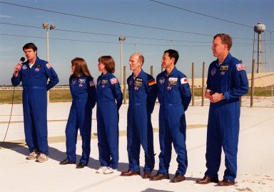 KENNEDY SPACE CENTER, Fla. -- The STS-99 crew take time out during Terminal Countdown Demonstration Test (TCDT) activities to talk to the media. From left to right are Commander Kevin Kregel, Mission Specialists Janet Lynn Kavandi (Ph.D.), Janice Voss (Ph.D.), Gerhard Thiele and Mamoru Mohri, and Pilot Dominic Gorie. Thiele is with the European Space Agency and Mohri is with the National Space Development Agency (NASDA) of Japan. The TCDT provides the crew with simulated countdown exercises, emergency egress training, and opportunities to inspect the mission payloads in the orbiter's payload bay. STS-99 is the Shuttle Radar Topography Mission, which will chart a new course, using two antennae and a 200-foot-long section of space station-derived mast protruding from the payload bay to produce unrivaled 3-D images of the Earth's surface. The result of the Shuttle Radar Topography Mission could be close to 1 trillion measurements of the Earth's topography. Besides contributing to the production of better maps, these measurements could lead to improved water drainage modeling, more realistic flight simulators, better locations for cell phone towers, and enhanced navigation safety. Launch of Endeavour on the 11-day mission is scheduled for Jan. 31 at 12:47 p.m. ES