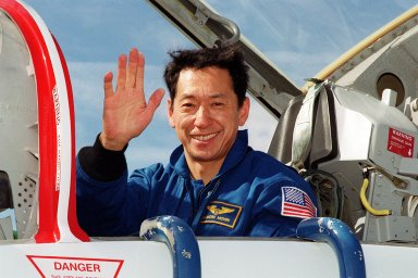 STS-99 Mission Specialist Mamoru Mohri (Ph.D.), who is with the National Space Development Agency (NASDA) of Japan, waves on his arrival at KSC aboard a T-38 jet aircraft to prepare for launch of Endeavour Jan. 31 at 12:47 p.m. EST. Over the next few days, the crew will review mission procedures, conduct test flights in the Shuttle Training Aircraft and undergo routine preflight medical exams. STS-99 is the Shuttle Radar Topography Mission, which will chart a new course, using two antennae and a 200-foot-long section of space station-derived mast protruding from the payload bay to produce unrivaled 3-D images of the Earth's surface. The result of the Shuttle Radar Topography Mission could be close to 1 trillion measurements of the Earth's topography. Besides contributing to the production of better maps, these measurements could lead to improved water drainage modeling, more realistic flight simulators, better locations for cell phone towers, and enhanced navigation safety