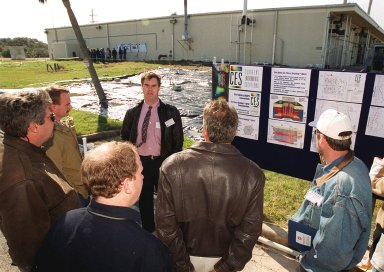 At Launch Complex 34, Greg Beyke, with Current Environmental Solutions, talks to representatives from environmental and federal agencies about the environmental research project that involves the Department of Defense, Environmental Protection Agency, Department of Energy and NASA in a groundwater cleanup effort. Concentrations of trichloroethylene solvent have been identified in the soil at the complex as a result of cleaning methods for rocket parts during the Apollo Program, which used the complex, in the 60s. The group formed the Interagency NDAPL Consortium (IDC) to study three contamination cleanup technologies: Six Phase Soil Heating, Steam Injection and In Situ Oxidation with Potassium Permanganate. All three methods may offer a way to remove the contaminants in months instead of decades. KSC hosted a two-day conference that presented information and demonstrations of the three technologies being tested at the site