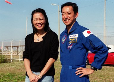 KENNEDY SPACE CENTER, Fla. -- The day before the expected launch of STS-99, Mission Specialist Mamoru Mohri (right) enjoys a reunion with his wife, Akiko, near Launch Pad 39A. STS-99, known as the Shuttle Radar Topography Mission (SRTM), is scheduled to lift off 12:47 p.m. EST from Launch Pad 39A. The SRTM will chart a new course to produce unrivaled 3-D images of the Earth's surface, using two antennae and a 200-foot-long section of space station-derived mast protruding from the payload bay. The result of the Shuttle Radar Topography Mission could be close to 1 trillion measurements of the Earth's topography. Besides contributing to the production of better maps, these measurements could lead to improved water drainage modeling, more realistic flight simulators, better locations for cell phone towers, and enhanced navigation safety. The mission is expected to last about 11days, with Endeavour landing at KSC Friday, Feb. 11, at 4:55 p.m