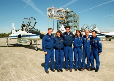 The STS-99 crew pose for a photograph after their arrival at the Shuttle Landing Facility to prepare for launch. From left are Pilot Dominic Gorie, Mission Specialist Janice Voss (Ph.D.), Commander Kevin Kregel, and Mission Specialists Janet Lynn Kavandi (Ph.D.), Gerhard Thiele (Ph.D.) and Mamoru Mohri (Ph.D.). Thiele is with the European Space Agency and Mohri is with the National Space Development Agency (NASDA) of Japan. Behind them are the T-38 jets in which they arrived, and the mate/demate device. Over the next few days, the crew will review mission procedures, conduct test flights in the Shuttle Training Aircraft and undergo routine preflight medical exams. STS-99 is the Shuttle Radar Topography Mission, which will chart a new course, using two antennae and a 200-foot-long section of space station-derived mast protruding from the payload bay to produce unrivaled 3-D images of the Earth's surface. The result of the Shuttle Radar Topography Mission could be close to 1 trillion measurements of the Earth's topography. Besides contributing to the production of better maps, these measurements could lead to improved water drainage modeling, more realistic flight simulators, better locations for cell phone towers, and enhanced navigation safety. Launch of Endeavour is scheduled for Jan. 31 at 12:47 p.m. EST