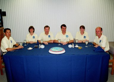 In the Operations and Checkout Building, the STS-99 crew gathers for breakfast before suiting up for launch. From left are Mission Specialists Mamoru Mohri (Ph.D.) and Janice Voss (Ph.D.); Pilot Dominic Gorie; Commander Kevin Kregel; and Mission Specialists Janet Lynn Kavandi (Ph.D.) and Gerhard Thiele. Mohri is with the National Space Development Agency (NASDA) of Japan, and Thiele is with the European Space Agency. Known as the Shuttle Radar Topography Mission, liftoff is scheduled for 12:47 p.m. EST from Launch Pad 39A. The SRTM will chart a new course to produce unrivaled 3-D images of the Earth's surface, using two antennae and a 200-foot-long section of space station-derived mast protruding from the payload bay. The result of the Shuttle Radar Topography Mission could be close to 1 trillion measurements of the Earth's topography. Besides contributing to the production of better maps, these measurements could lead to improved water drainage modeling, more realistic flight simulators, better locations for cell phone towers, and enhanced navigation safety. The mission is expected to last about 11days, with Endeavour landing at KSC Friday, Feb. 11, at 4:55 p.m. EST