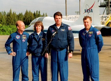 On the runway at the Shuttle Landing Facility, STS-99 crew members Mission Specialists Gerhard Thiele and Janice Voss, Commander Kevin Kregel and Pilot Dominic Gorie briefly talk to the media about their imminent departure to Houston. Kregel and Gorie will be piloting T-38 jets with Voss and Thiele as passengers. During the Jan. 31 launch countdown, Endeavour's enhanced master events controller (E-MEC) No. 2 failed a standard preflight test. Launch was postponed and Shuttle managers decided to replace the E-MEC located in the orbiter's aft compartment. Launch controllers will be in a position to begin the STS-99 countdown the morning of Feb. 6 and ready to support a launch midto late next week pending availability of the Eastern Range. The postponed launch gives the crew an opportunity for more training and time with their families. Known as the Shuttle Radar Topography Mission, it will chart a new course to produce unrivaled 3-D images of the Earth's surface, using two antennae and a 200-foot-long section of space station-derived mast protruding from the payload bay. The result could be close to 1 trillion measurements of the Earth's topography. Besides contributing to the production of better maps, these measurements could lead to improved water drainage modeling, more realistic flight simulators, better locations for cell phone towers, and enhanced navigation safety