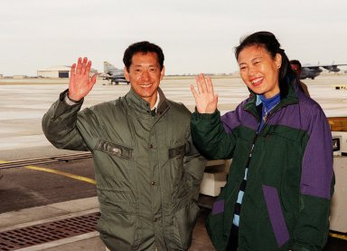 STS-99 Mission Specialist Mamoru Mohri of Japan and his wife, Akiko, wave before their departure from Patrick Air Force Base and return to Houston. With the postponement of the launch of STS-99 on Jan. 31, the crew have an opportunity for more training and time with their families. During the launch countdown, Endeavour's enhanced master events controller (E-MEC) No. 2 failed a standard preflight test. Launch was postponed and Shuttle managers decided to replace the E-MEC located in the orbiter's aft compartment. Launch controllers will be in a position to begin the STS-99 countdown the morning of Feb. 6 and ready to support a launch midto late next week pending availability of the Eastern Range. Known as the Shuttle Radar Topography Mission, it will chart a new course to produce unrivaled 3-D images of the Earth's surface, using two antennae and a 200-foot-long section of space station-derived mast protruding from the payload bay. The result could be close to 1 trillion measurements of the Earth's topography. Besides contributing to the production of better maps, these measurements could lead to improved water drainage modeling, more realistic flight simulators, better locations for cell phone towers, and enhanced navigation safety
