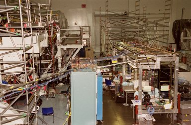 The Space Station Processing Facility (SSPF) appears overflowing with racks and wires being used to support work on elements of the International Space Station. Currently housed in the SSPF are the U.S. Lab Destiny and the Multi-Purpose Logistics Modules Leonardo and Raffaello. Destiny, element 5A of the station, is scheduled for launch on mission STS-98 in August; Leonardo, element 5A.1, on mission STS-102 in October; and Raffaello, element 6A, on mission STS-100 in November