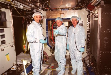 Looking over equipment inside the U.S. Lab Destiny as part of a Multi-Equipment Interface Test are STS-98 Pilot Mark Polansky (left) and Commander Kenneth D. Cockrell (center). They are joined by astronaut James Voss (right), who will be among the first crew to inhabit the International Space Station on a flight in late 2000. During the STS-98 mission, the crew will install the Lab on the station during a series of three space walks. The mission will provide the station with science research facilities and expand its power, life support and control capabilities. The U.S. Laboratory Module continues a long tradition of microgravity materials research, first conducted by Skylab and later Shuttle and Spacelab missions. Destiny is expected to be a major feature in future research, providing facilities for biotechnology, fluid physics, combustion, and life sciences research. Others in the five-member crew on STS-98 are Mission Specialists Robert L. Curbeam Jr., Thomas D. Jones (Ph.D.) and Marsha S. Ivins. The Lab is planned for launch aboard Space Shuttle Atlantis on the sixth ISS flight, currently targeted no earlier than Aug. 19, 2000