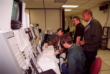 Workers in the Space Station Processing Facility control room check documentation during a Multi-Equipment Interface Test (MEIT) in the U.S. Lab Destiny. Members of the STS-98 crew are taking part in the MEIT checking out some of the equipment in the Lab. During the STS-98 mission, the crew will install the Lab on the station during a series of three space walks. The crew comprises five members: Commander Kenneth D. Cockrell, Pilot Mark L. Polansky, and Mission Specialists Robert L. Curbeam Jr., Thomas D. Jones (Ph.D.) and Marsha S. Ivins. The mission will provide the station with science research facilities and expand its power, life support and control capabilities. The U.S. Laboratory Module continues a long tradition of microgravity materials research, first conducted by Skylab and later Shuttle and Spacelab missions. Destiny is expected to be a major feature in future research, providing facilities for biotechnology, fluid physics, combustion, and life sciences research. The Lab is planned for launch aboard Space Shuttle Atlantis on the sixth ISS flight, currently targeted no earlier than Aug. 19, 2000