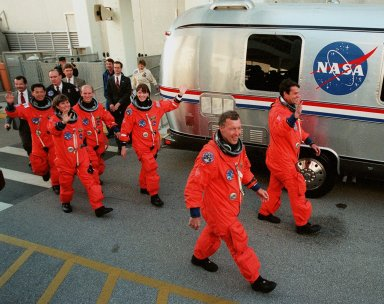"The STS-99 crew step eagerly to the ""Astrovan,"" the bus that will take them to Launch Pad 39A for liftoff of Space Shuttle Endeavour. In their orange launch and entry suits, they are (left to right) Mission Specialists Mamoru Mohri of Japan, Janice Voss, Gerhard Thiele of Germany and Janet Lynn Kavandi, Pilot Dominic Gorie and Commander Kevin Kregel. Mohri is with the National Space Development Agency (NASDA) of Japan, and Thiele is with the European Space Agency. Known as the Shuttle Radar Topography Mission (SRTM), STS-99 is scheduled for liftoff at 12:30 p.m. EST. The SRTM will chart a new course to produce unrivaled 3-D images of the Earth's surface. The result of the Shuttle Radar Topography Mission could be close to 1 trillion measurements of the Earth's topography. The mission is expected to last 11days, with Endeavour landing at KSC Tuesday, Feb. 22, at 4:36 p.m. EST. This is the 97th Shuttle flight and 14th for Shuttle Endeavour"