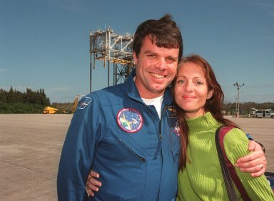At the Shuttle Landing Facility, STS-99 Commander Kevin Kregel is joined by his wife, Jeanne, before their departure for Houston. The STS-99 crew completed a successful 11-day Shuttle Radar Topography Mission mapping 47 million square miles of the Earth's surface before landing at KSC Feb. 22