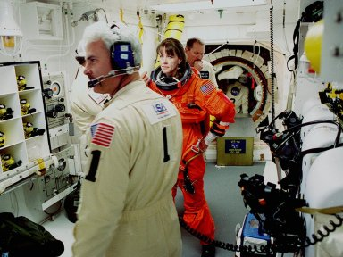 Before entering the orbiter Endeavour, STS-99 Mission Specialist Janet Kavandi is helped with final suit preparations by members of the White Room closeout crew Travis Thompson (hidden), mechanical technician, and Chris Meinert, closeout chief. The White Room is an environmental chamber at the end of the orbiter access arm, on the fixed service structure, that provides entry to the orbiter crew compartment. STS-99, known as the Shuttle Radar Topography Mission (SRTM), will chart a new course to produce unrivaled 3-D images of the Earth's surface. The result of the Shuttle Radar Topography Mission could be close to 1 trillion measurements of the Earth's topography. Scheduled for liftoff at 12:30 p.m. EST, the mission is expected to last 11days, with Endeavour landing at KSC Tuesday, Feb. 22, at 4:36 p.m. EST. This is the 97th Shuttle flight and 14th for Shuttle Endeavour