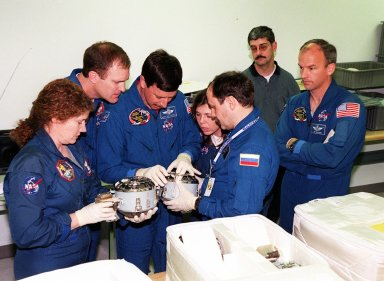 KENNEDY SPACE CENTER, FLA. -- Members of the STS-101 crew take part in Crew Equipment Interface Test (CEIT) activities at SPACEHAB, in Cape Canaveral, Fla., where they are learning about some of the equipment they will be working with on their mission to the International Space Station. Looking over two of the components are (left to right) Mission Specialist Susan Helms, Commander James Halsell, Pilot Scott Horowitz, and Mission Specialists Mary Ellen Weber, Yuri Usachev and Jeffrey Williams. Not shown is Mission Specialist James Voss. The STS-101 crew will be responsible for preparing the Space Station for the arrival of the Zvezda Service Module, expected to be launched by Russia in July 2000. Also, the crew will conduct one space walk to perform maintenance on the Space Station and deliver logistics and supplies. This will be the third assembly flight for the Space Station. STS-101 is scheduled to launch no earlier than April 13 from Launch Pad 39A