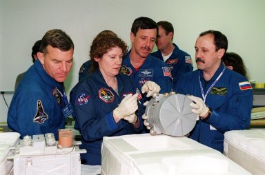 KENNEDY SPACE CENTER, FLA. -- At SPACEHAB, in Cape Canaveral, Fla., members of the STS-101 crew take part in Crew Equipment Interface Test (CEIT) activities, learning about some of the equipment they will be working with on their mission to the International Space Station. Looking over one of the elements are (left to right) Mission Specialists James Voss and Susan Helms, Pilot Scott Horowitz, and Mission Specialist Yuri Usachev of Russia. Seen behind Horowitz is Commander James Halsell. Also taking part in the CEIT are Mission Specialists Mary Ellen Weber and Jeffrey Williams. The STS-101 crew will be responsible for preparing the Space Station for the arrival of the Zvezda Service Module, expected to be launched by Russia in July 2000. Also, the crew will conduct one space walk to perform maintenance on the Space Station and deliver logistics and supplies. This will be the third assembly flight for the Space Station. STS-101 is scheduled to launch no earlier than April 13 from Launch Pad 39A