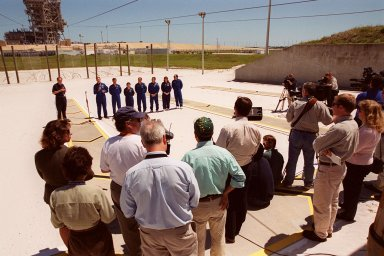 """KENNEDY SPACE CENTER, Fla. -- After Terminal Countdown Demonstration Test (TCDT) activities at Launch Pad 39A, the STS-101 crew answer questions from the media. Standing in the background (left to right) are moderator George Diller, with NASA Public Affairs; Commander James D. Halsell Jr., with the microphone; Pilot Scott J. """"Doc"""" Horowitz; and Mission Specialists Mary Ellen Weber, Jeffrey N. Williams, James Voss, Susan J. Helms and Yuri Usachev of Russia. The TCDT includes emergency egress training and a simulated launch countdown. During their mission to the International Space Station, the STS-101 crew will be delivering logistics and supplies, plus preparing the Station for the arrival of the Zvezda Service Module, expected to be launched by Russia in July 2000. Also, the crew will conduct one space walk to perform maintenance on the Space Station. This will be the third assembly flight for the Space Station. STS-101 is scheduled to launch April 24 at 4:15 p.m. from Launch Pad 39A"""